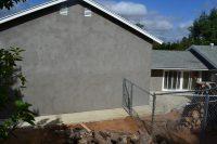 stucco wall room over garage addition